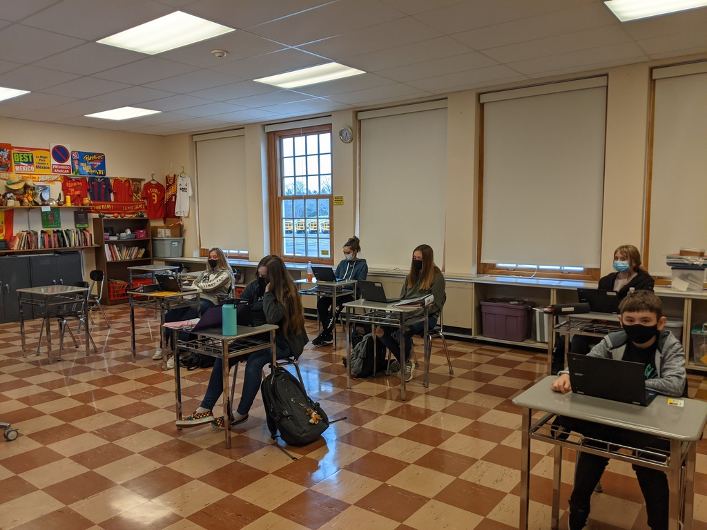 a group of students socially distanced in a classroom