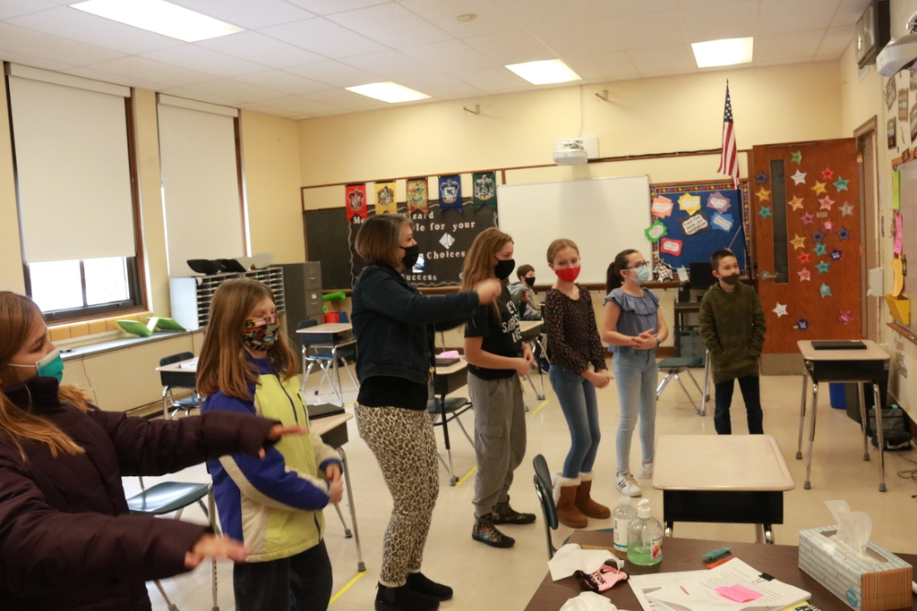 students and a teacher doing viral dances