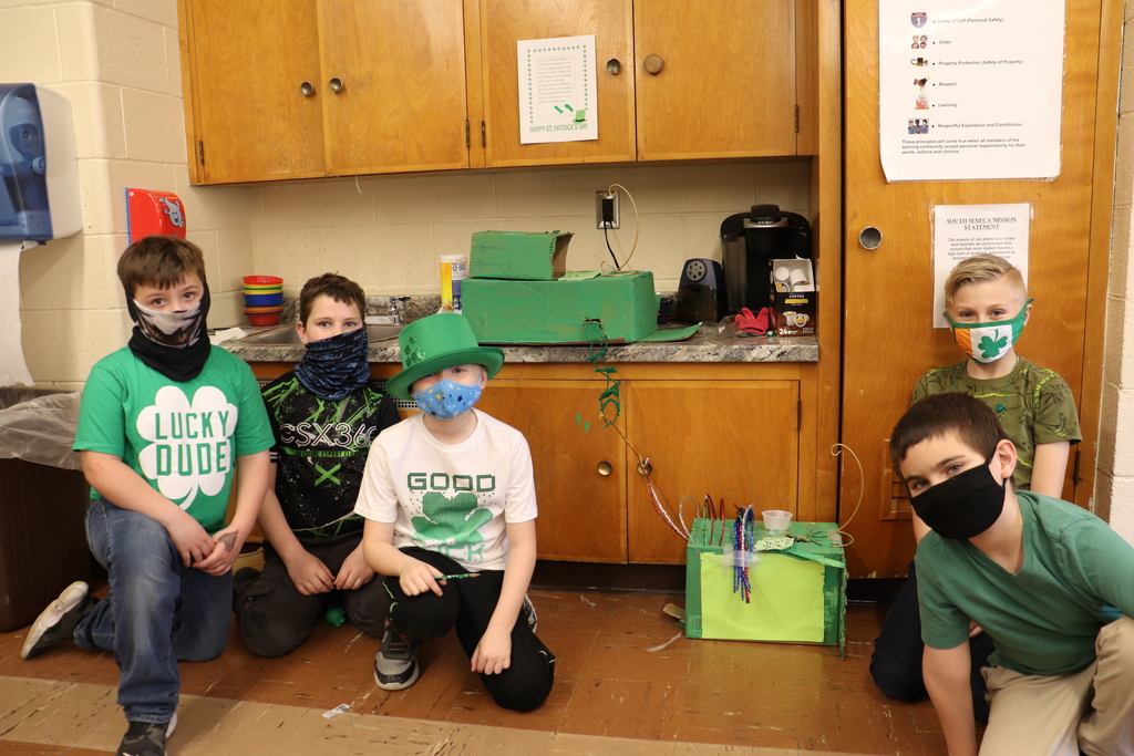 students posing with leprechaun traps