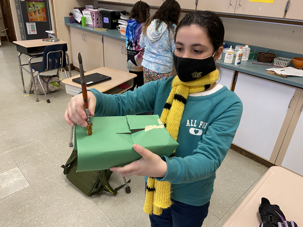 student showing off completed leprechaun trap